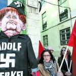 Меркель снова обозвали Гитлером…